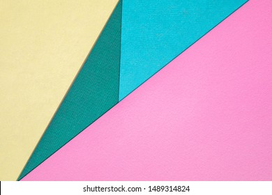 Abstract different pastel colored paper backgrounds with place for text. Diagonal geometric composition. Top view.