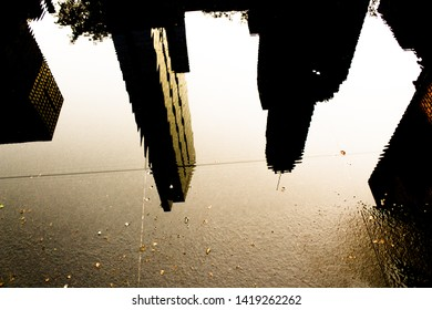 Abstract distorted Chicago skyline silhouette reflected of a puddle