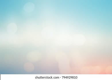 abstract double exposure of blurred beautiful natural soft  beauty sky landscape background and ray flare light bokeh bulb.