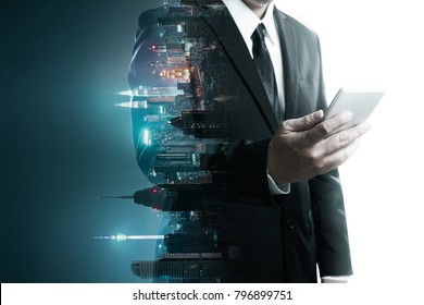 Abstract double exposure image of businessman man using mobile smart phone mix with flip night creative city background . Always stay connected concept .