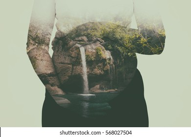 Abstract Double exposure of pregnant women and waterfall in forest,mountain landscape,clipping path.