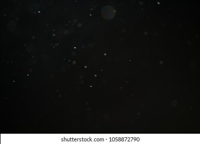 abstract dust particles over black background for overlay