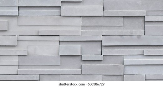 Abstract elegance seamless beige grey pattern of  modern square slate stone block wall texture for background and wallpaper, horizontal line