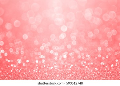 Abstract elegant coral pink, peach and salmon color glitter sparkle confetti background or party invite for happy birthday, Christmas bokeh, mother's day, Spring, pale pastel easter flyer or wedding