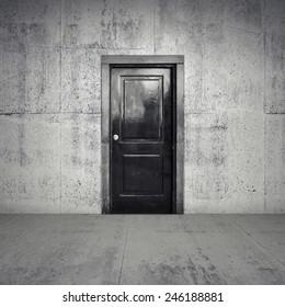 Abstract empty concrete interior with old black wooden door