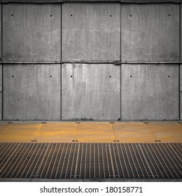 Abstract empty industrial interior with concrete wall and rusted steel floor
