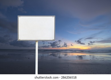 Abstract empty rectangular white sign over sun rise beach background