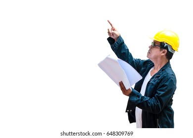 abstract engineer contractor wearing yellow helmet will point  for checking work with paper plan with isolated white background