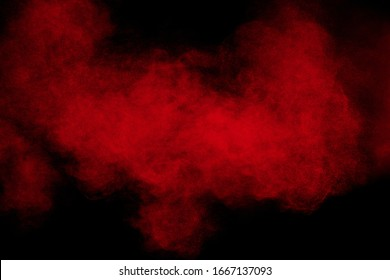 Abstract explosion of red powder on black background Freeze motion of red powder splash.
