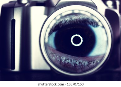 abstract eye in camera lens- ink saturated conceptual background
