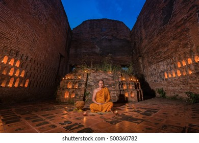 An abstract fantasy photograph of a Buddhist monk meditating old temple in Thailand.Priest temple.The priest was meditation.The monks were introspection.
