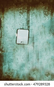 abstract  fearful background with Empty plate on a concrete wall.