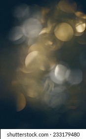 Abstract Festive background. Christmas and New Year feast bokeh background with copyspace. Vintage photography effect. Retro grainy color film look.