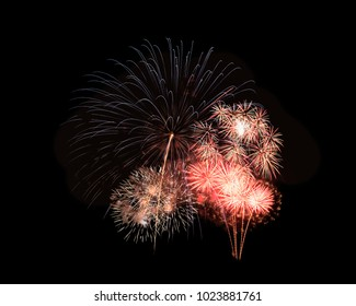 Abstract festive colorful fireworks explosion, isolated on black background