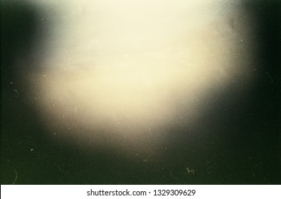 Abstract film texture background with heavy grain, dust and light leak