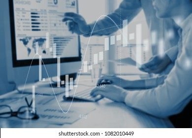 Abstract finance concept with people discussing financial data on a business analytics dashboard on computer screen in background and stock market investment chart in foreground