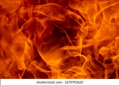 Abstract fire flame glowing burning on black dark background, fireplace for firefighter to safety, photo for creative graphic design wallpaper texture surface, beautiful flame light motion of bonfire
