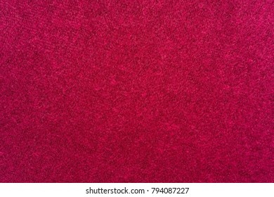 abstract fluffy fleecy texture of fabric or textile material of crimson color for a background or for wallpaper