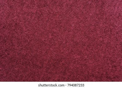 abstract fluffy fleecy texture of fabric or textile material of claret color for a background or for wallpaper
