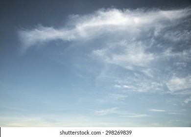 Abstract fluffy white cloud over blue sky background