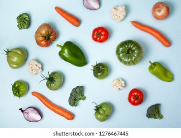 abstract food background. fresh vegetables on a blue background. view from above
