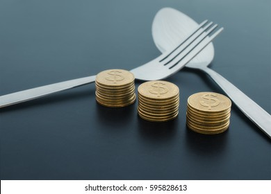 abstract fork and money on dark board business saving money concept.