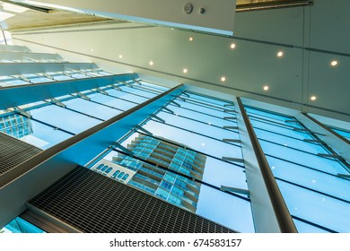 Abstract fragment of the architecture of modern lobby, hallway of the luxury hotel, shopping mall, business center. Interior design.