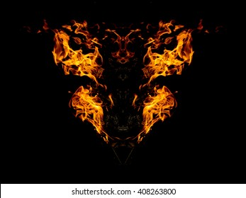 abstract frame of fire on dark background , demon face style of photo