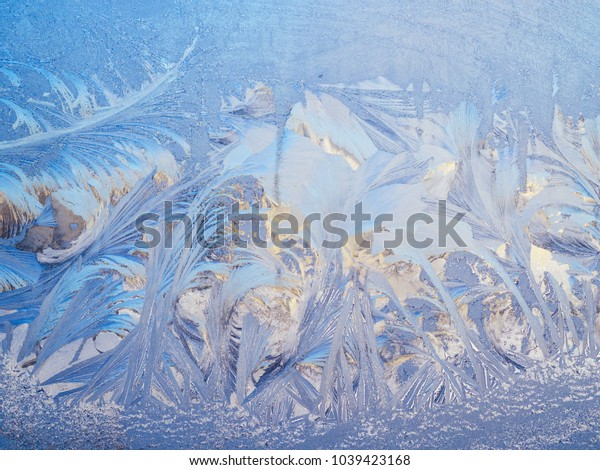 abstract frost texture on a glass window in winter