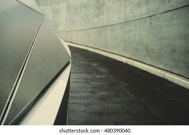 Abstract futuristic background. Diagonal geometric lines, concrete and black asphalt.