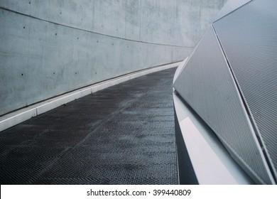 Abstract futuristic background. Diagonal lines, concrete and black asphalt.