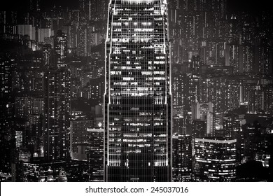 Abstract futuristic night cityscape with illuminated skyscrapers.Hong Kong black and white background
