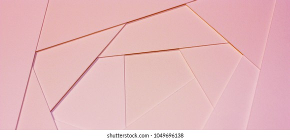 Abstract geometric background in light pastel tones from sheets of thick pale pink paper, cardboard. Suitable as design element, separate project, cover for website. Horizontal.