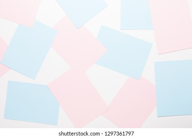 Abstract geometric background in light pastel tones from sheets of thick pale past paper.