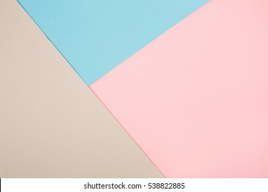 Abstract geometric paper background. Blue, pink and gray trend colors.