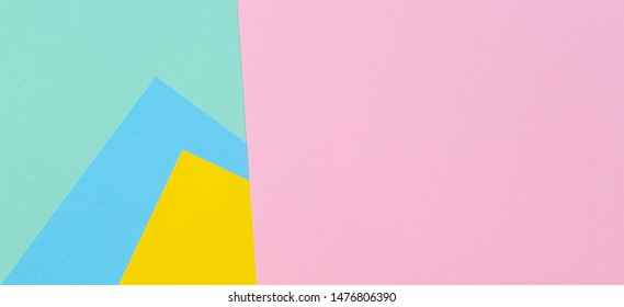 Abstract geometric paper texture background with trendy colors pastel pink, yellow, light blue and green color