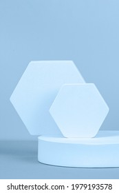 Abstract geometric product display podium on light blue background. Minimal different shapes scene stage showcase stand for product promotion presentation