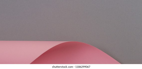 Abstract geometric shape gray and pink color paper background.