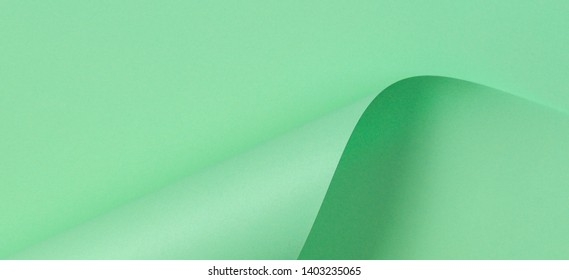 Abstract geometric shape pastel green paper background