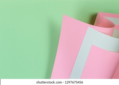 Abstract geometric shape pastel pink and green color paper background