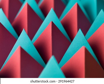abstract geometrical background with colorful paper pyramids. selective focus