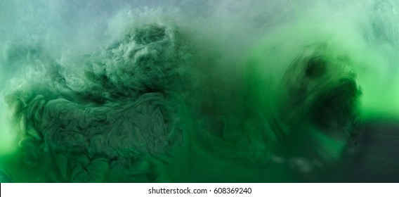 Abstract ghost of ink. Green scary monster in water