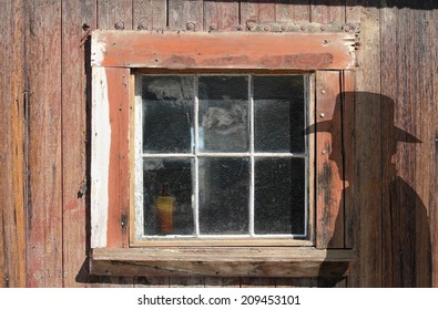 An abstract ghost town window with a silhouette of a cowboy.