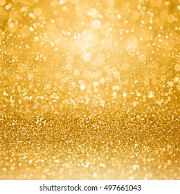 Abstract glamorous gold glitter sparkle confetti background or glitzy glam luxury golden color party invite for birthday, anniversary, wedding, new year's eve or Christmas