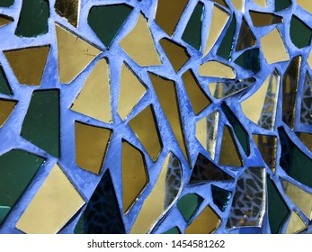 Abstract glass mosaic and broken tiles on blue wall background, mosaic background, texture mosaic.