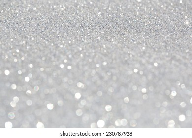 Abstract glitter festive silver background frame with shining stars and galaxy like feel. Christmas decorative and festivity celebration background texture. Luxury texture white glitter.