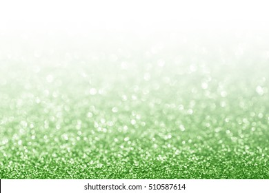 Abstract glitter green background with white copy space
