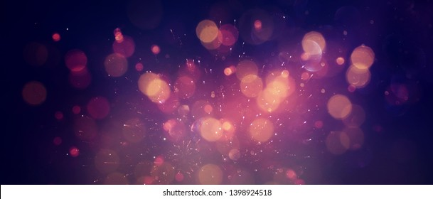 abstract glitter lights background. red, black, purple and gold. de-focused. banner