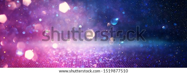 abstract glitter pink, purple and blue lights background. de-focused. banner