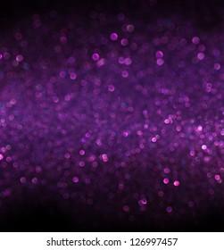 abstract glitter purple lights  background